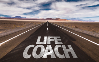 "On an open, flat road that is moving forward lists the words ""life coach."""